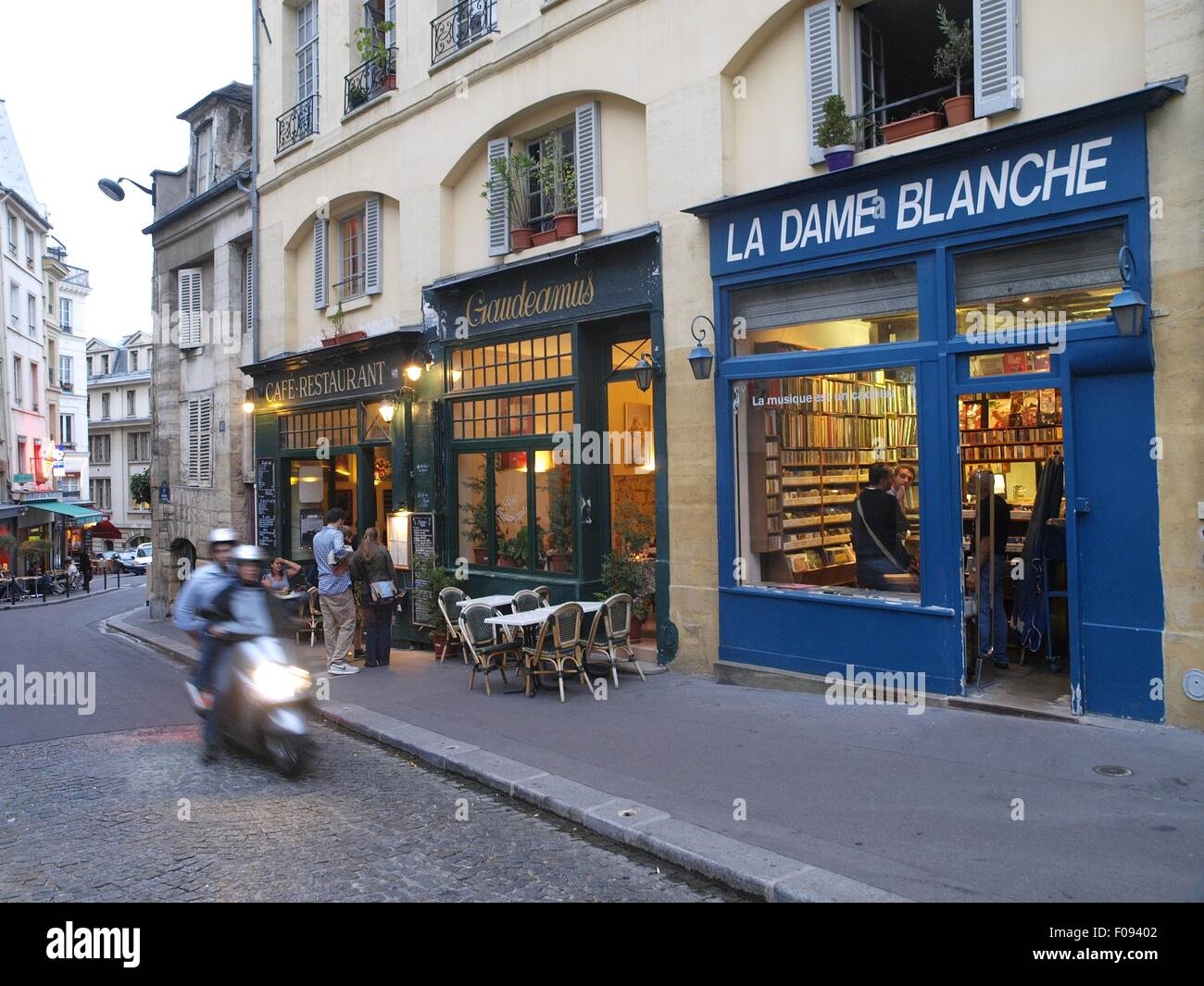 View Of Cafe And Shops On Roadside In Paris France Stock