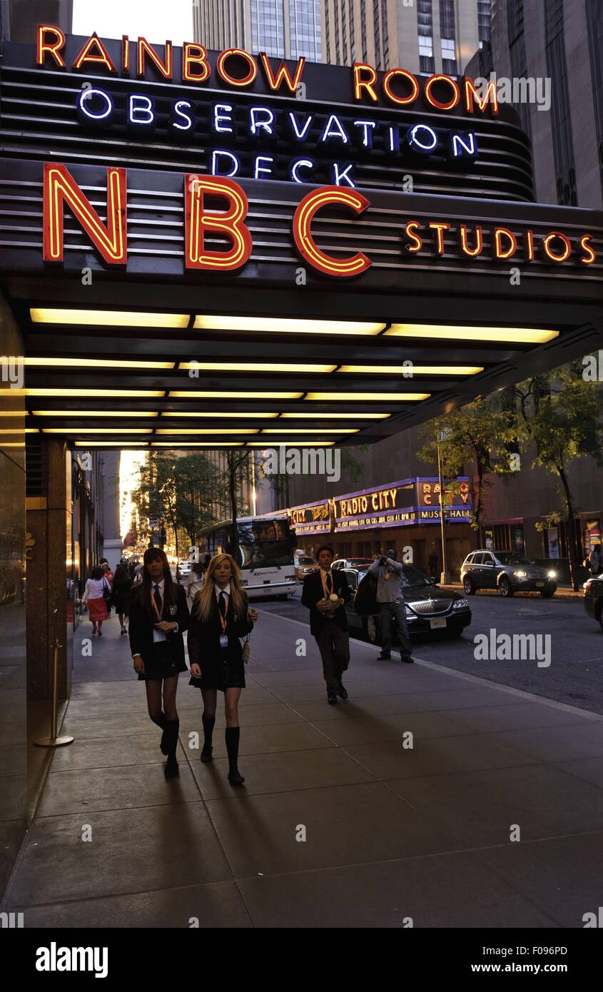People walking in front of entrance of NBC Studios in Rockefeller Centre, New York, USA - Stock Image