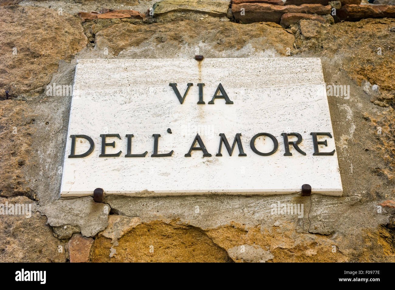 Pienza, Tuscany, Italy. Via dell' amore sign on wall. - Stock Image