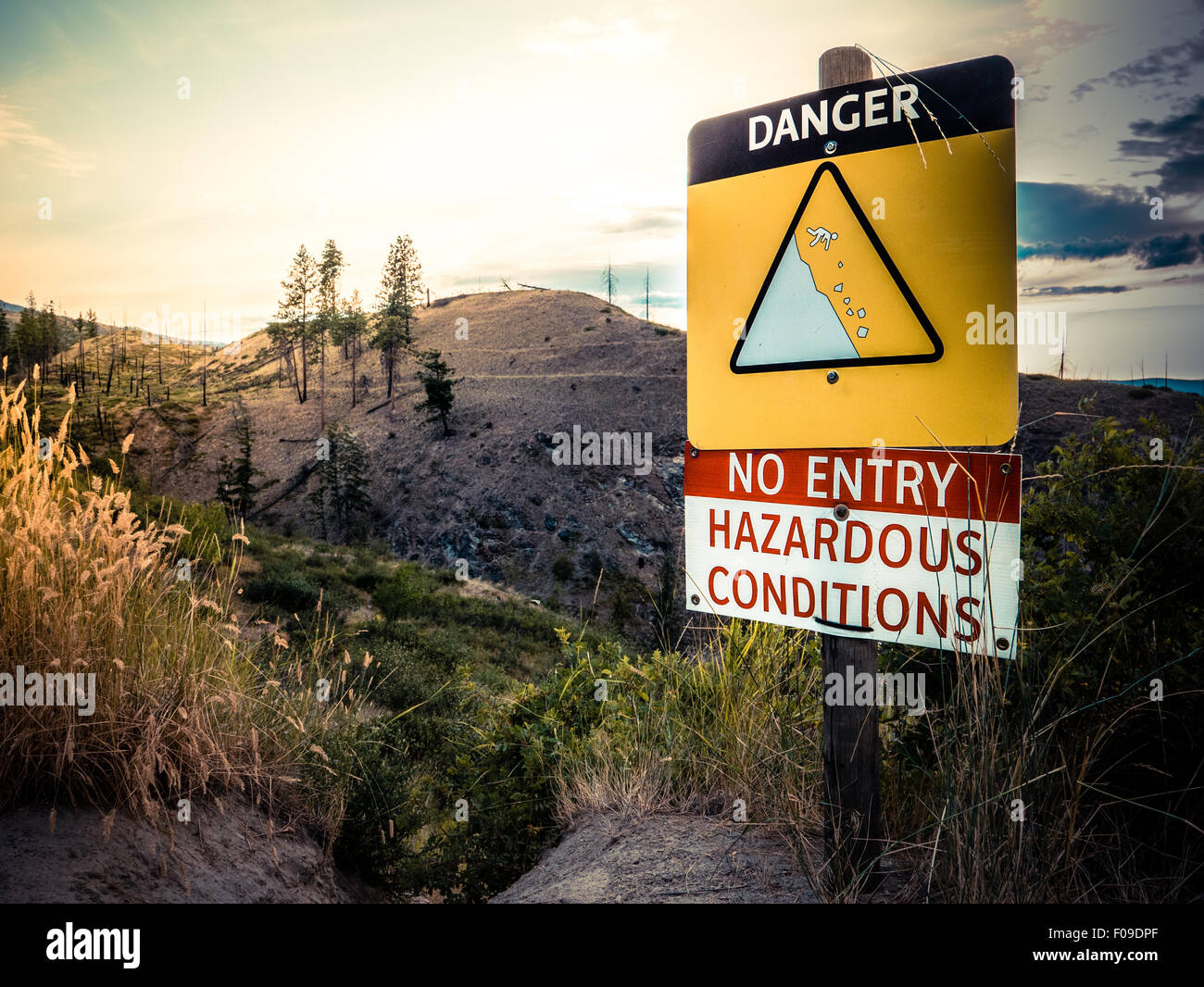 A Danger Sign On The Edge Of Cliff On A Hiking Trail - Stock Image
