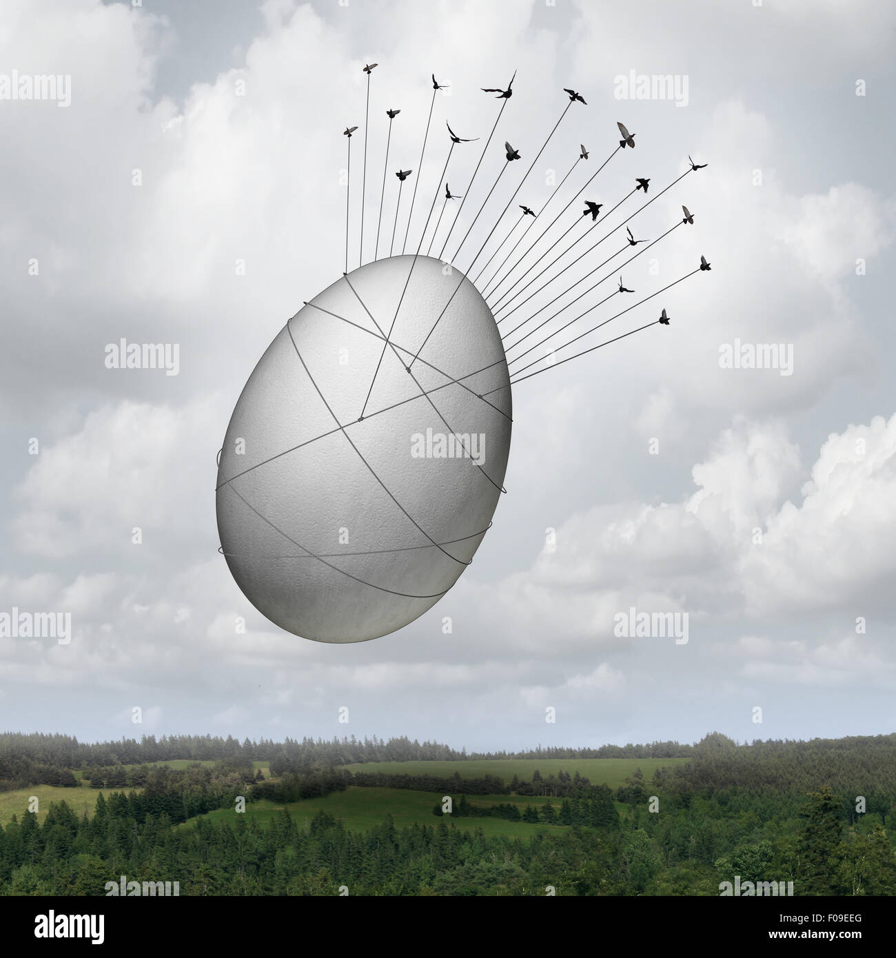 Common goal business concept as a collective team of birds pulling a giant egg with ropes as a financial security - Stock Image
