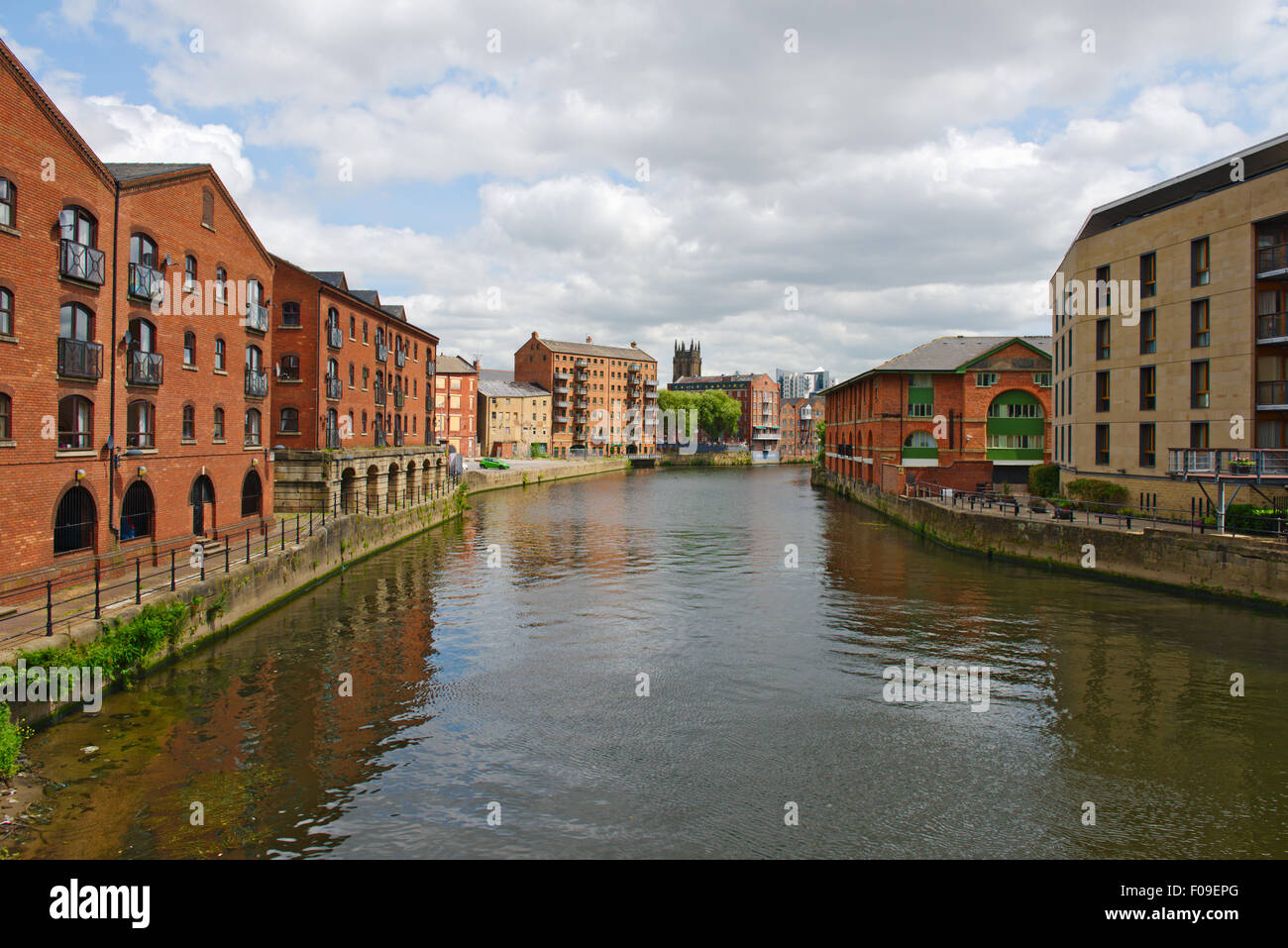 River Aire in central Leeds with offices and flats, some converted from old warehouses, West Yorkshire, UK - Stock Image