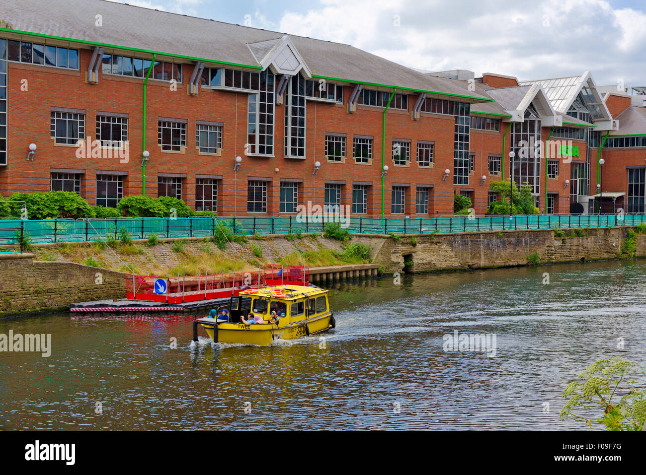 River Aire in central Leeds with ASDA head offices, West Yorkshire, UK - Stock Image