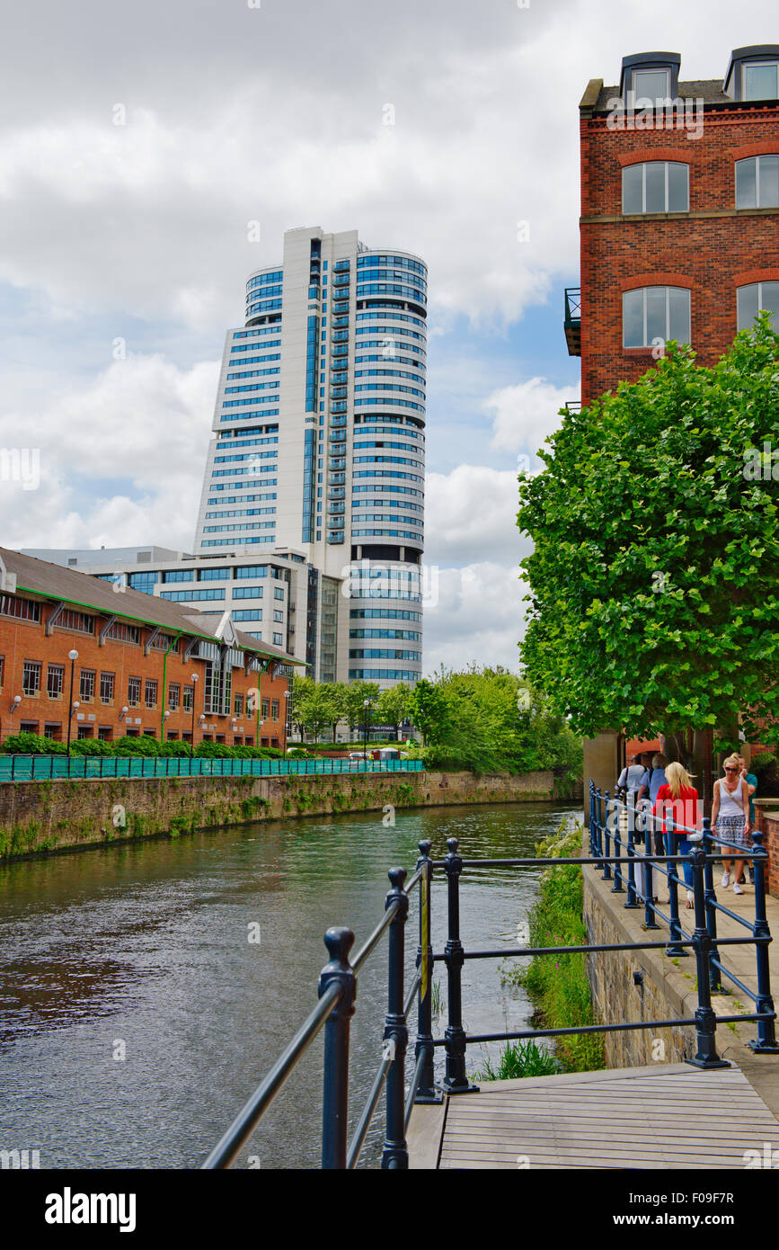Riverside walk along River Aire in central Leeds with offices, flats and Clarence House , West Yorkshire, UK - Stock Image