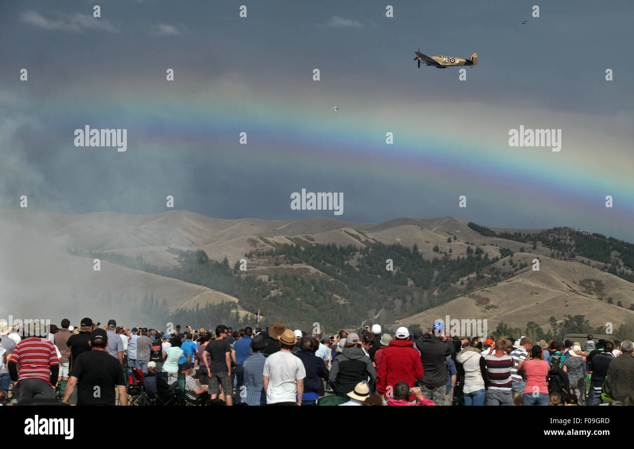 A lone Spitfire flies over the crowd at Omaka's Classic Fighters, 2015, Marlborough, New Zealand - Stock Image