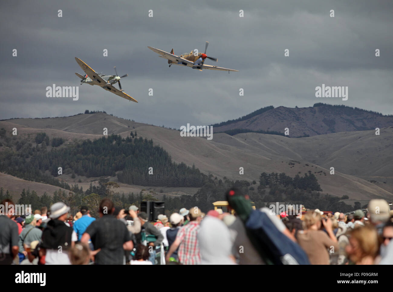 Two Spitfires fly over the crowd at Omaka's Classic Fighters, 2015, Marlborough, New Zealand - Stock Image