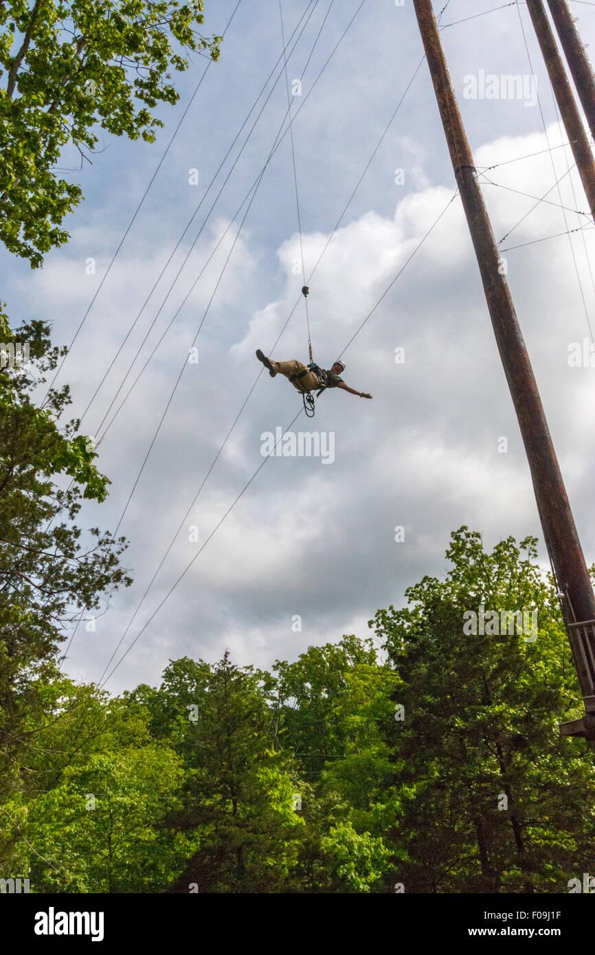 100 foot drop during zipline adventure at Branson Zipline Canopy Tours in Branson, MO. Stock Photo