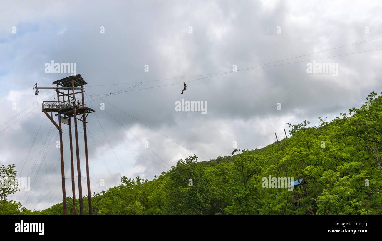 Zipline adventure at Branson Zipline Canopy Tours in Branson, MO. Stock Photo