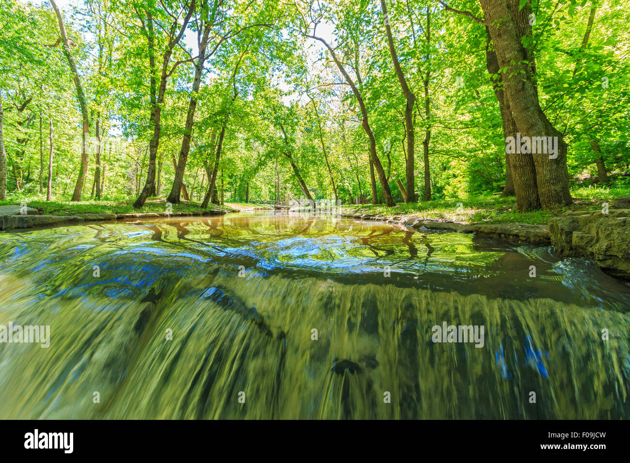 One of the many waterfalls at Dogwood Canyon Nature Park near Branson, MO., seen from an unusual angle - Stock Image