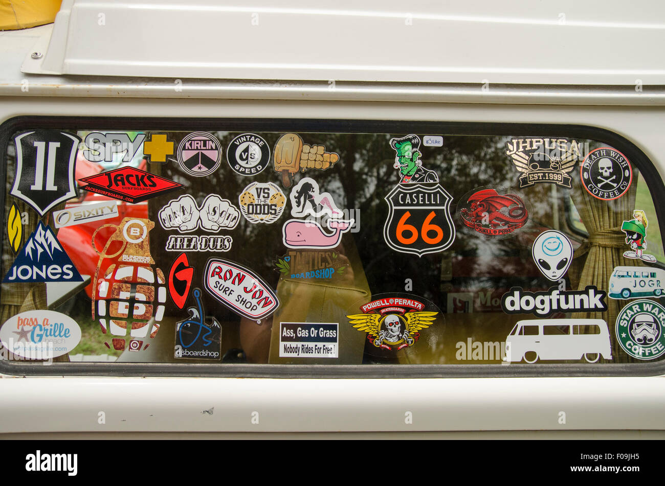 Sticker covered window of Volkswagen Bus at VW's over the Skyway car show. - Stock Image