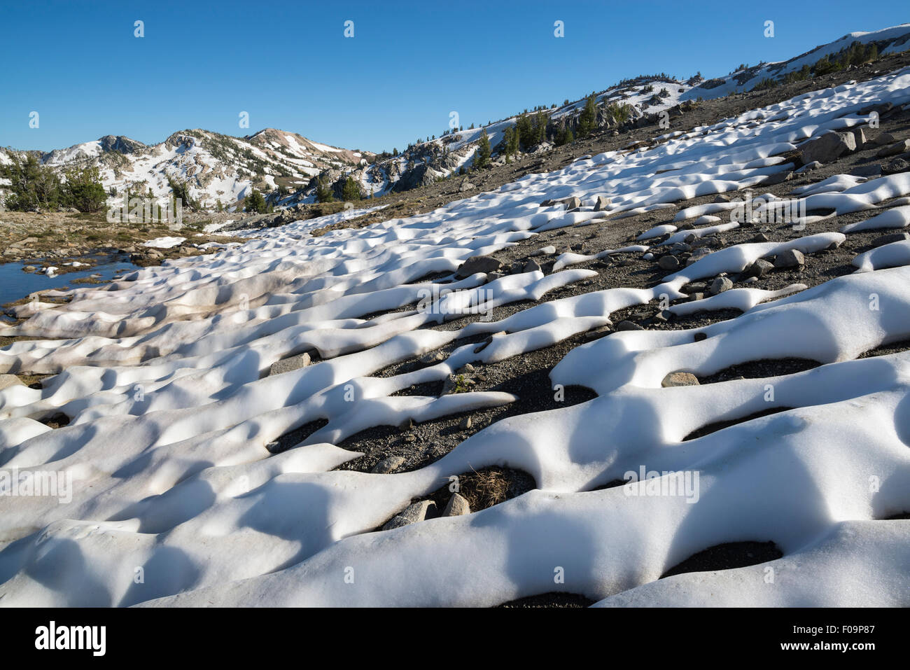 Melting snowfield, Wallowa Mountains, Oregon. - Stock Image