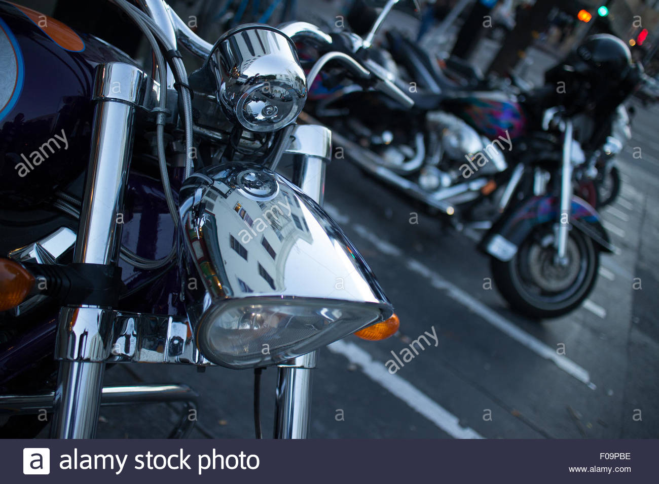 Detail of chrome headlamp on a cruiser style motorcycle in San Francisco, California. - Stock Image
