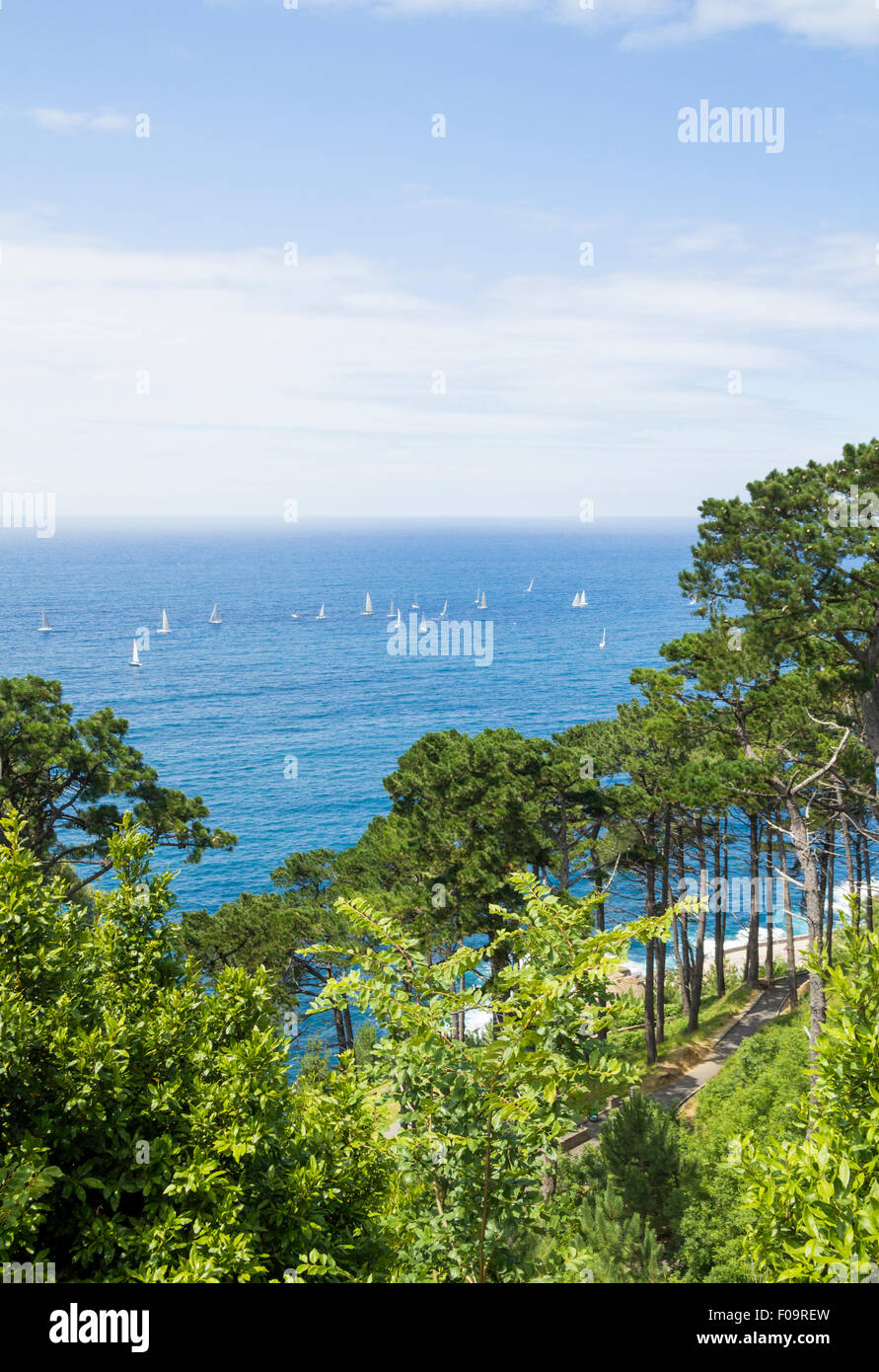 Yachts sailing off the coast of San Sebastian (Donostia), Basque Country, northern Spain - Stock Image