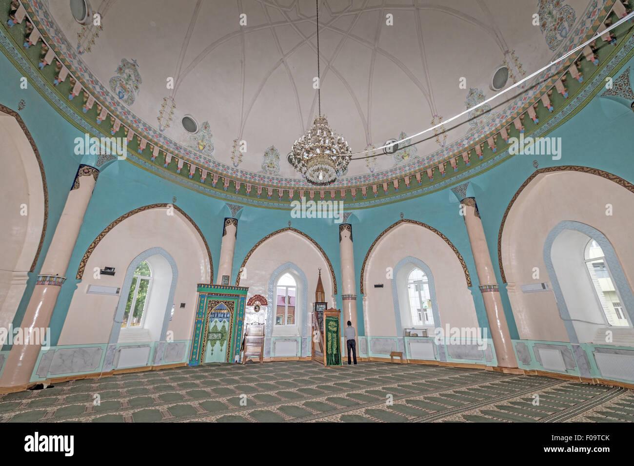 man praying Juma Mosque  Quba Azerbaijan Stock Photo