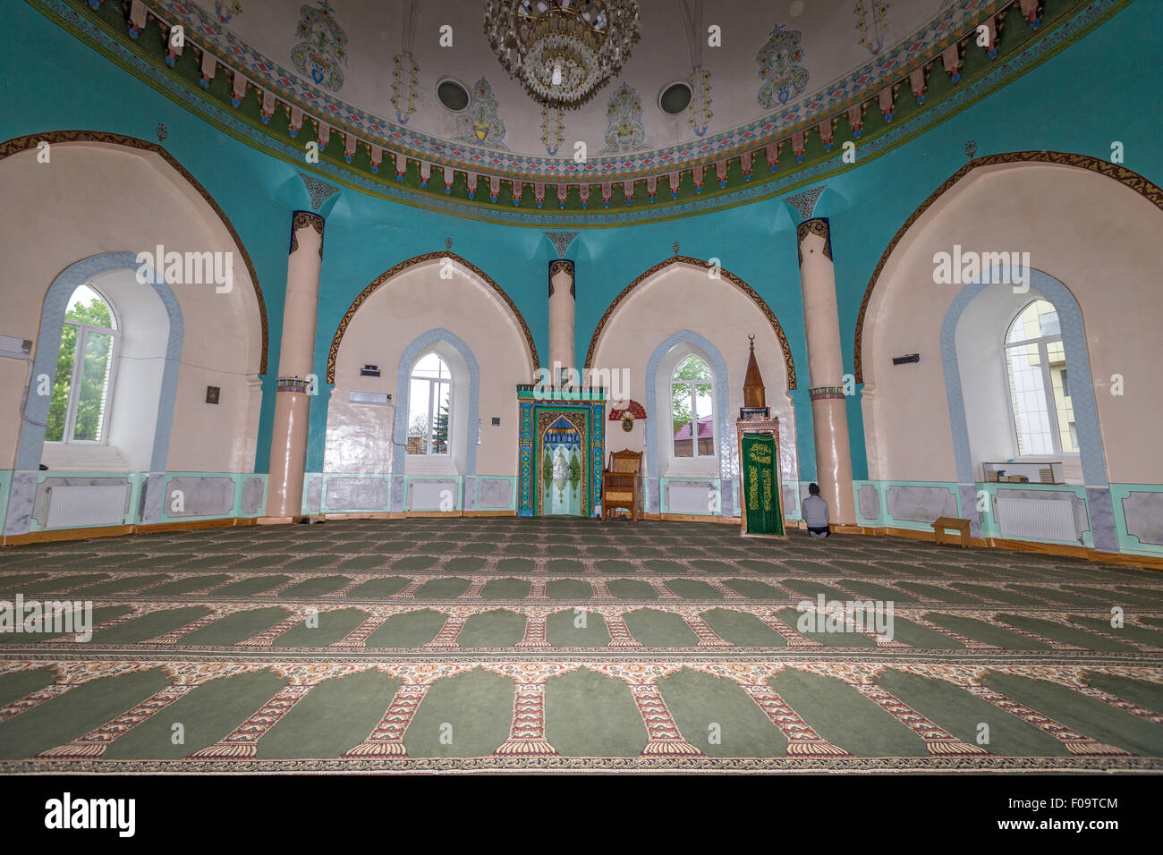man praying Juma Mosque  Quba Azerbaijan - Stock Image