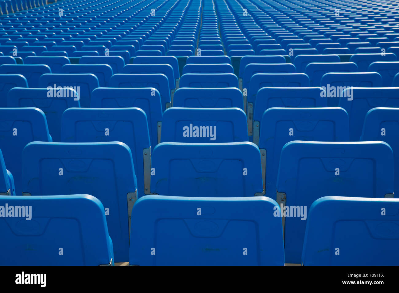 Rows of blue concert chairs. - Stock Image