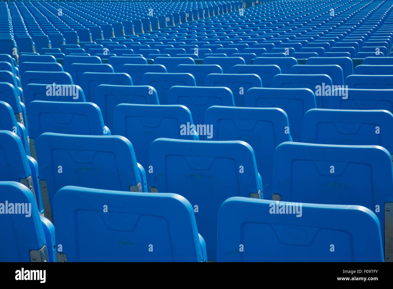 Rows of blue chairs - Stock Image