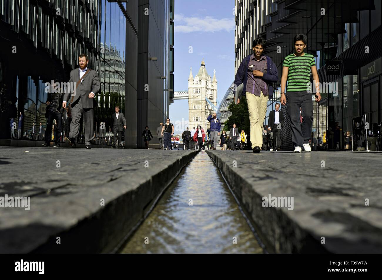 Low angle view of people and Rill and Tower Bridge, Borough of Southwark, London, England - Stock Image