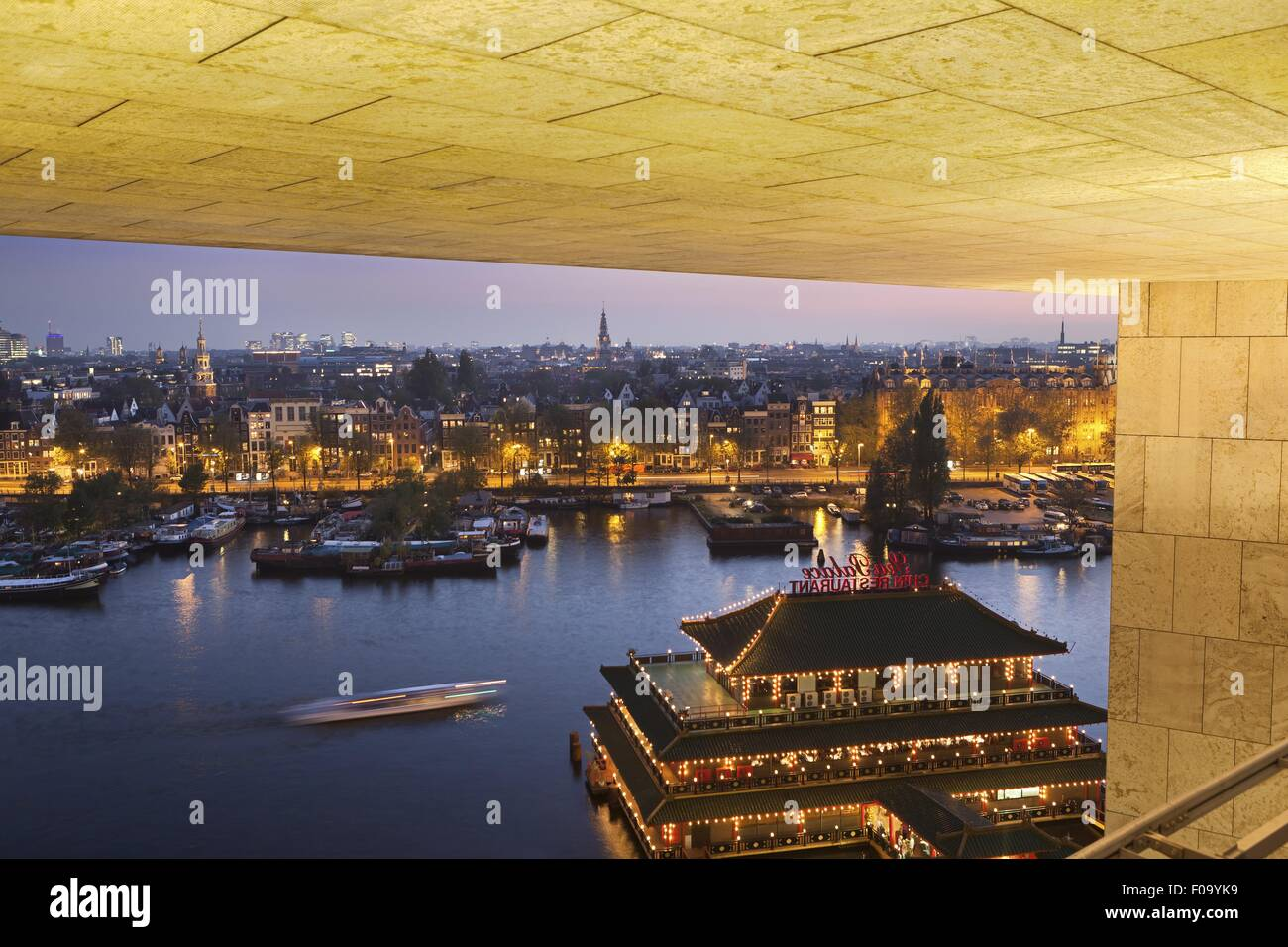 View of illuminated Old Town from roof terrace of public library, Amsterdam, Netherlands - Stock Image