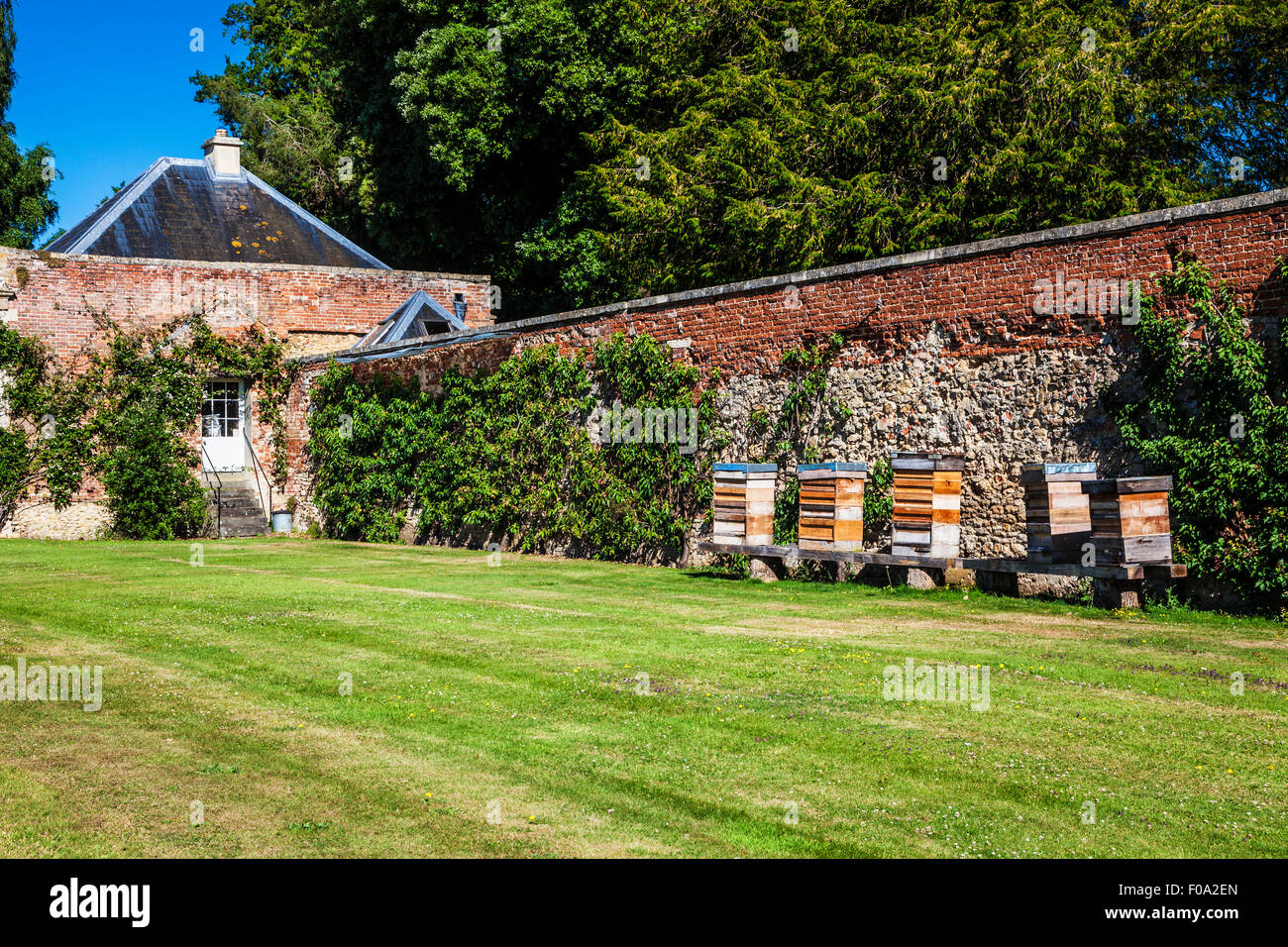 Bee hives in the walled gardens at Bowood House in Wiltshire. - Stock Image