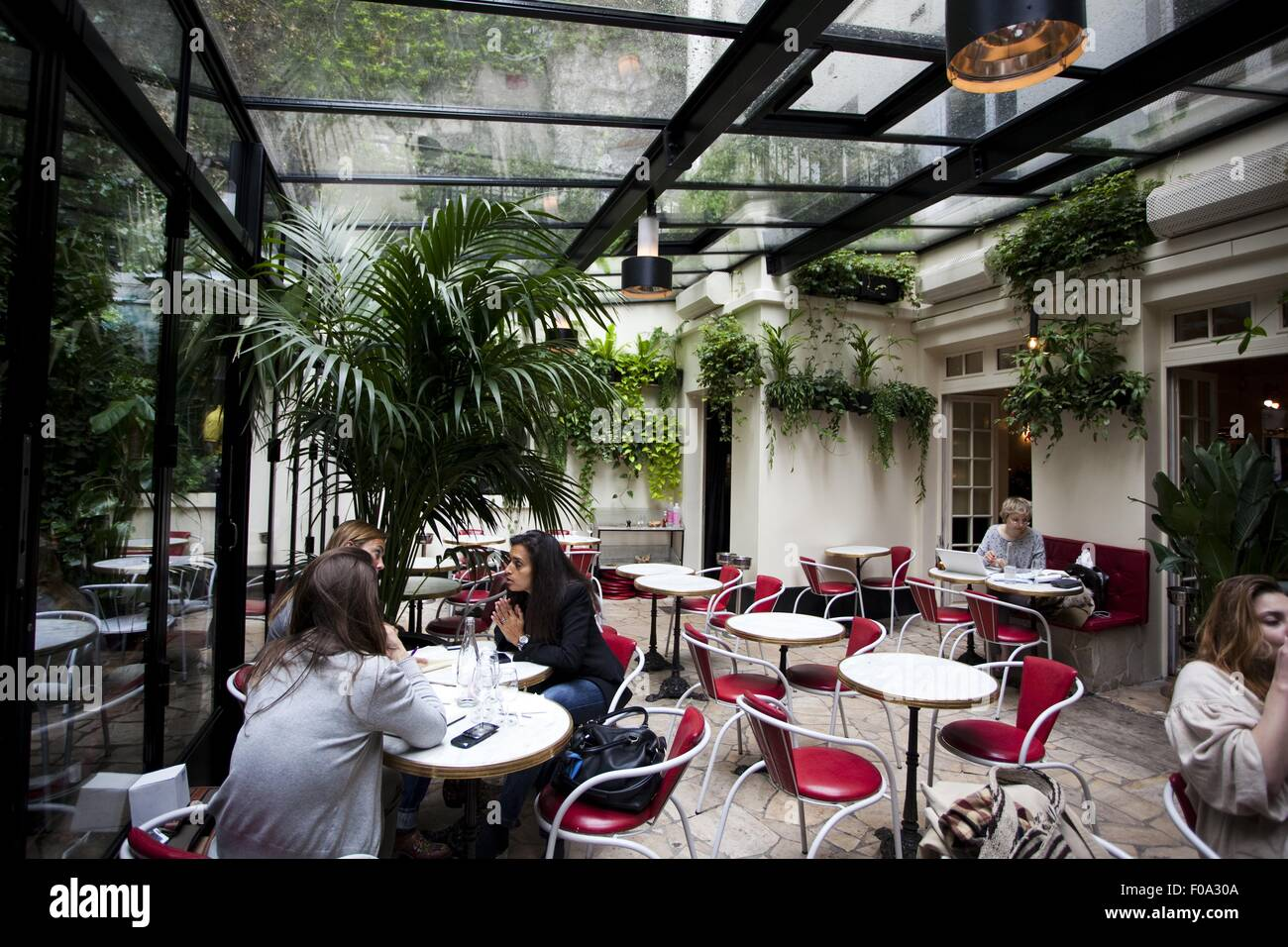 People Sitting In Patio Of Hotel Amour Paris France Stock Photo