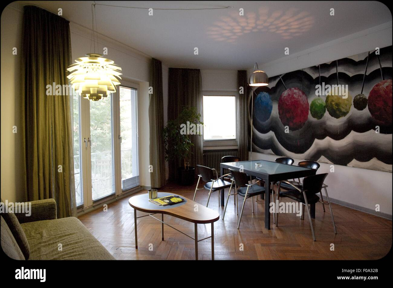 Interior of Hotel Chelsea with designer furniture and painted wall, Cologne, Germany - Stock Image