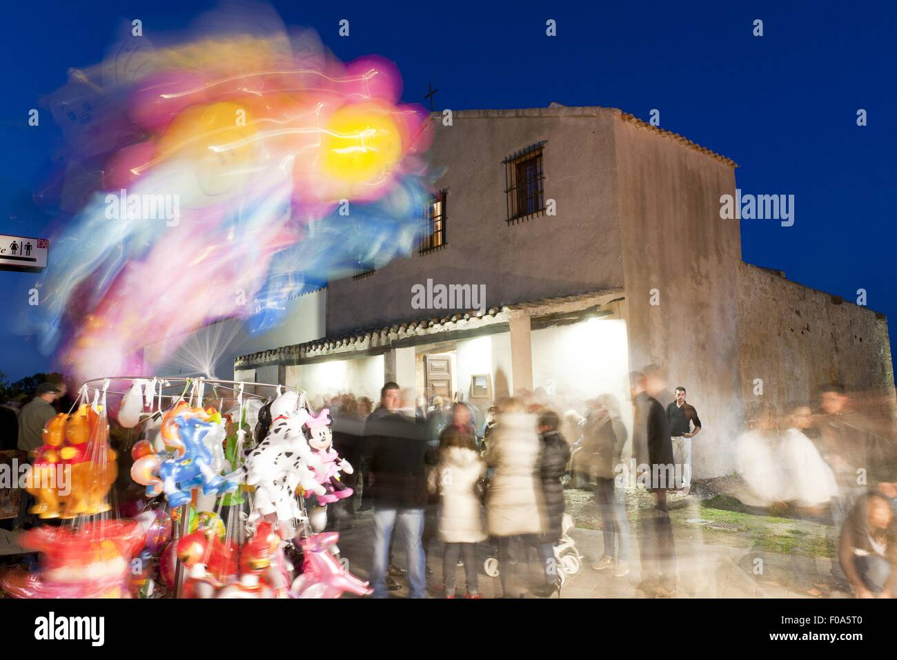 People at Sant'Efisio Church at blue hour, Nora, Cagliari, Sardinia, Italy, blurred motion - Stock Image