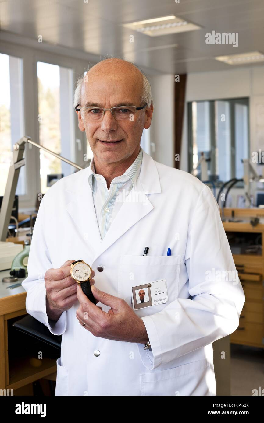 Senior man holding watch, Le sentier, Vallee de Joux, Switzerland - Stock Image