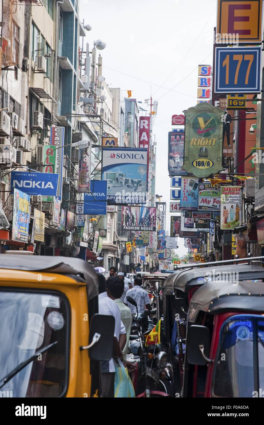Rush hour on street with signboards in Colombo, Sri Lanka - Stock Image