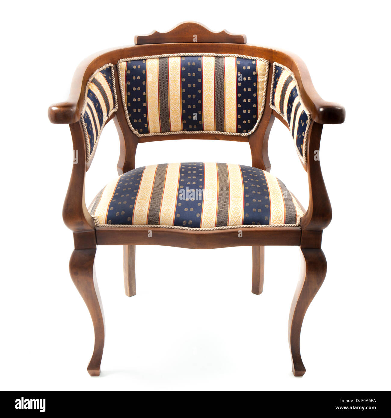 Image of an old retro style armchair upholstered in striped fabric. The chair is in the center of a square frame - Stock Image