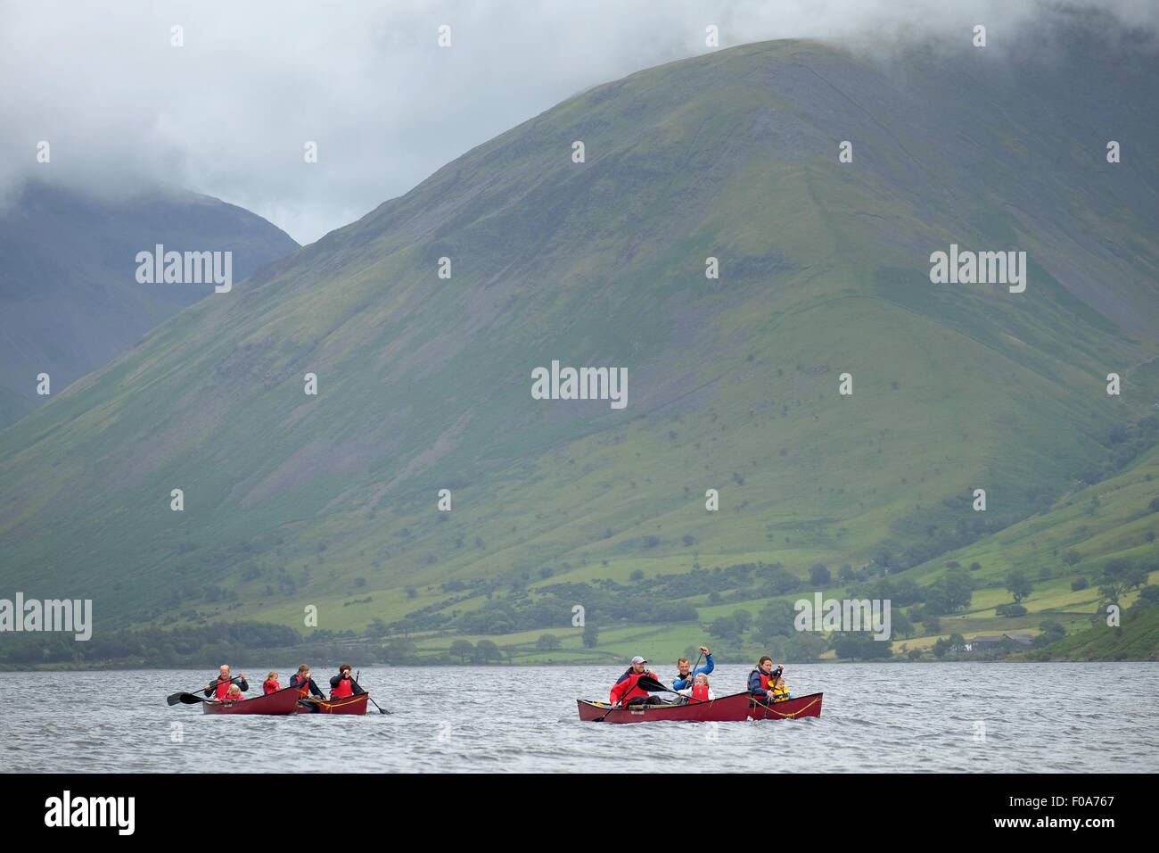 A group of people in canoe boats on Wastwater in the Lake District, Cumbria, UK - Stock Image