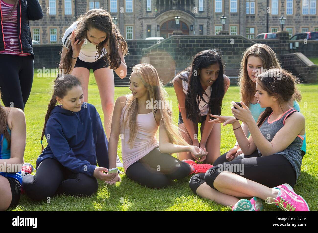 Group of students taking break in field - Stock Image