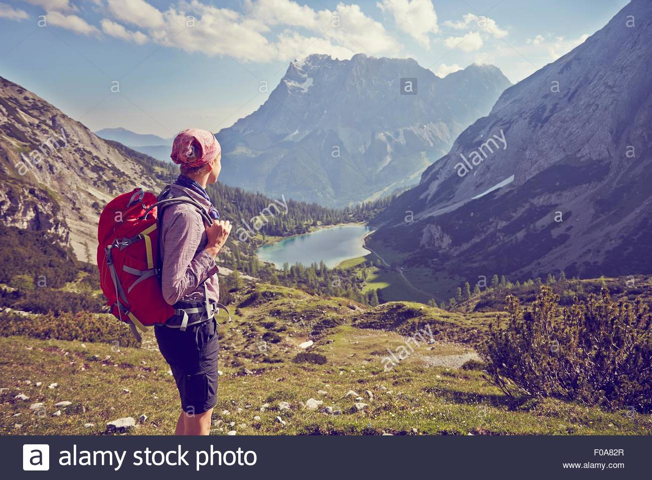 Mature woman, hiking down mountain, looking at view, Ehrwald, Tyrol, Austria - Stock Image