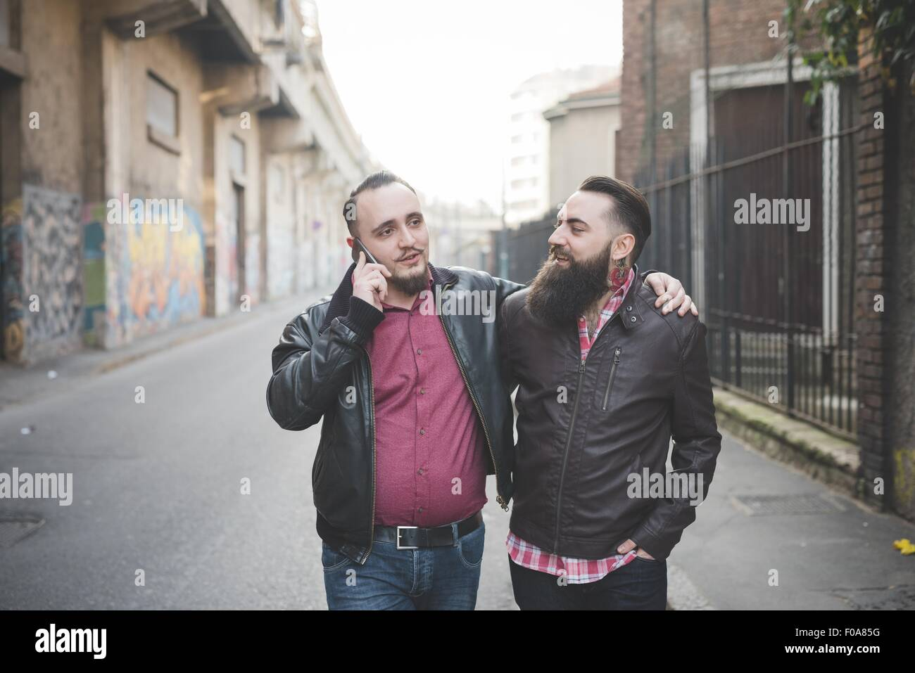 Gay couple walking on street Stock Photo