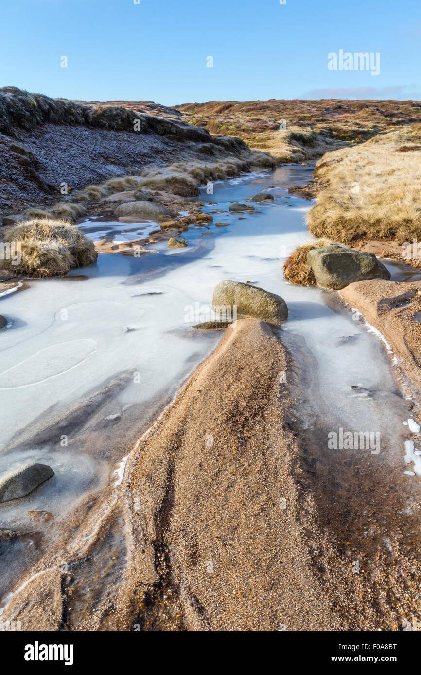 A frozen stream on Edale Moor on Kinder Scout, Derbyshire, The Peak District National Park, England, UK - Stock Image