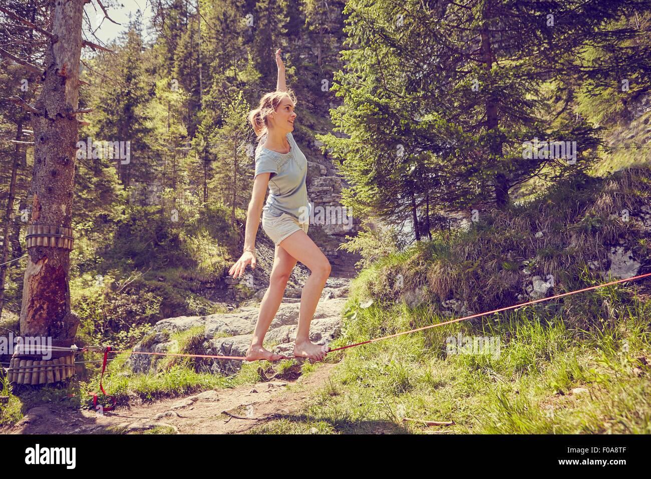 Woman balancing on rope, Ehrwald, Tyrol, Austria - Stock Image