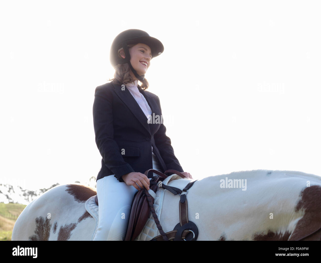 Teenage girl riding horse - Stock Image