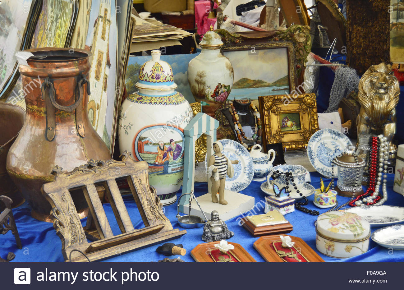Detail of stall with antiquities at flea market in Port Vell Barcelona Catalonia Spain Europe - Stock Image