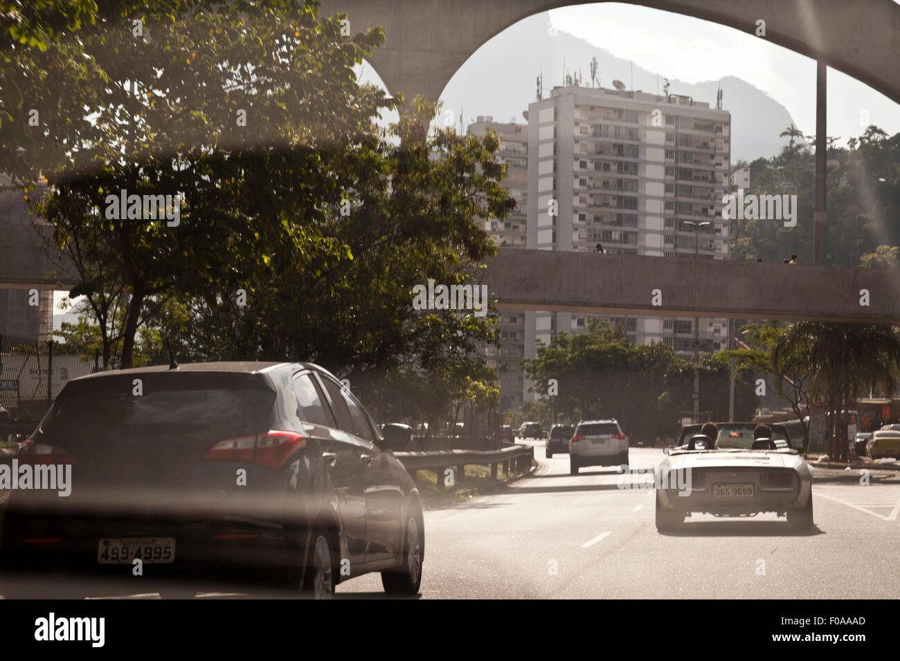 Cars travelling on road, rear view - Stock Image