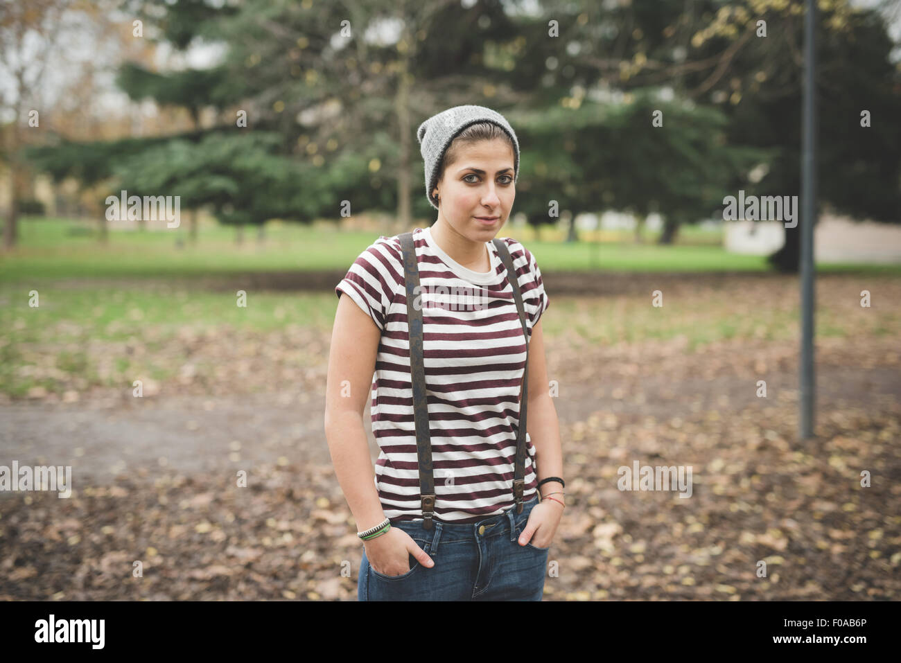 Teenager in park - Stock Image