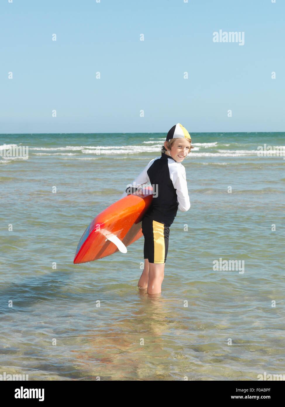 Portrait of boy nipper (child surf life savers) looking backwards, Altona, Melbourne, Australia - Stock Image