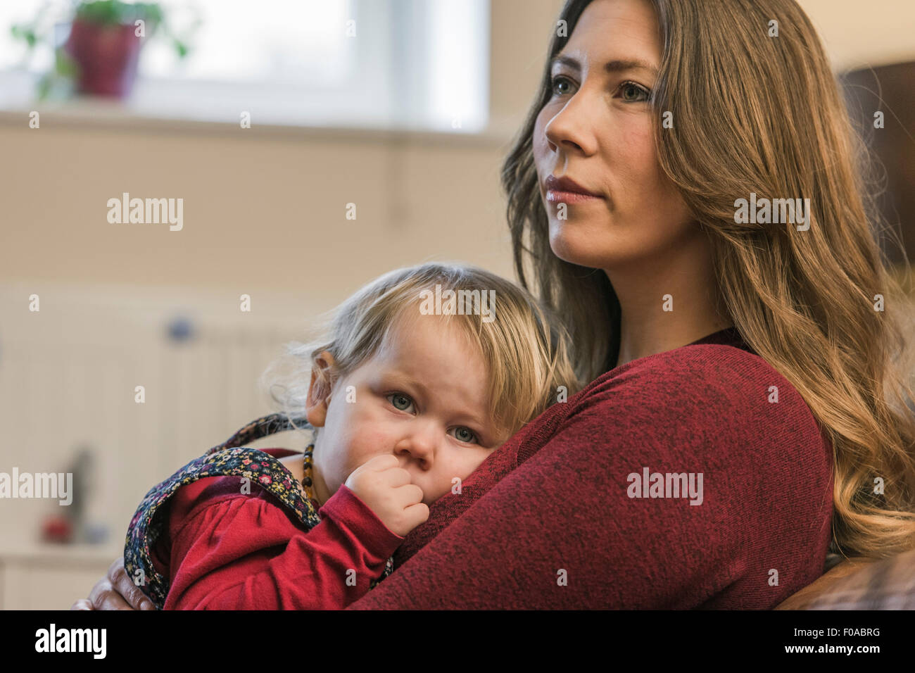 Woman and child relaxing at home Stock Photo