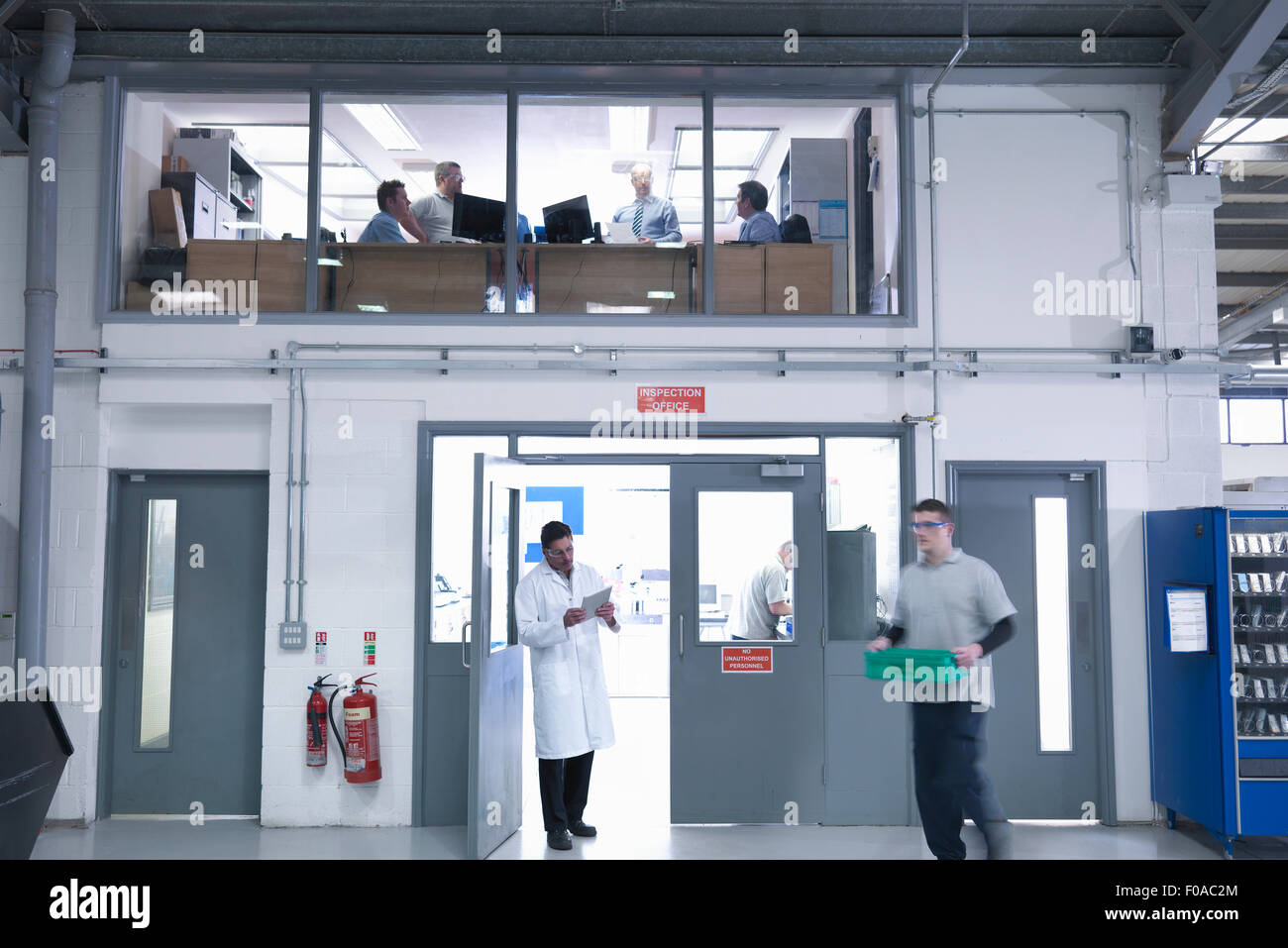 View of offices and testing station in factory - Stock Image