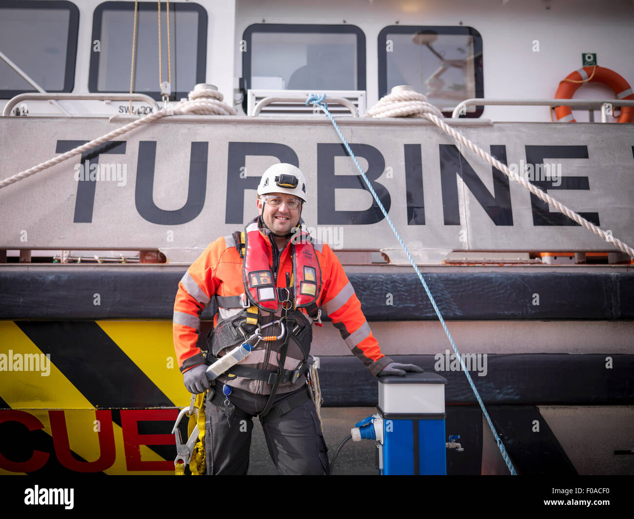 Portrait of offshore windfarm engineer in port - Stock Image