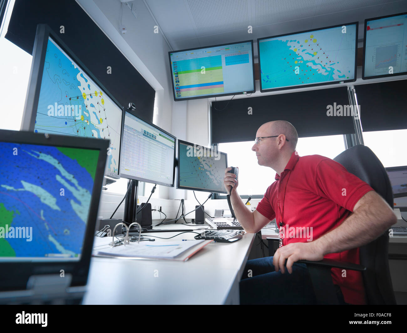 Operator in offshore windfarm control room - Stock Image