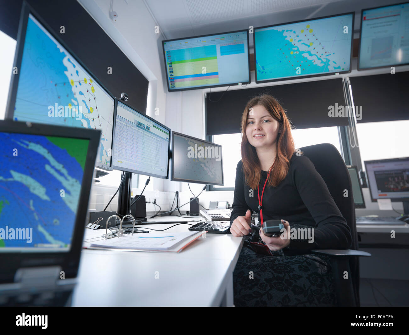 Portrait of operator in offshore windfarm control room - Stock Image