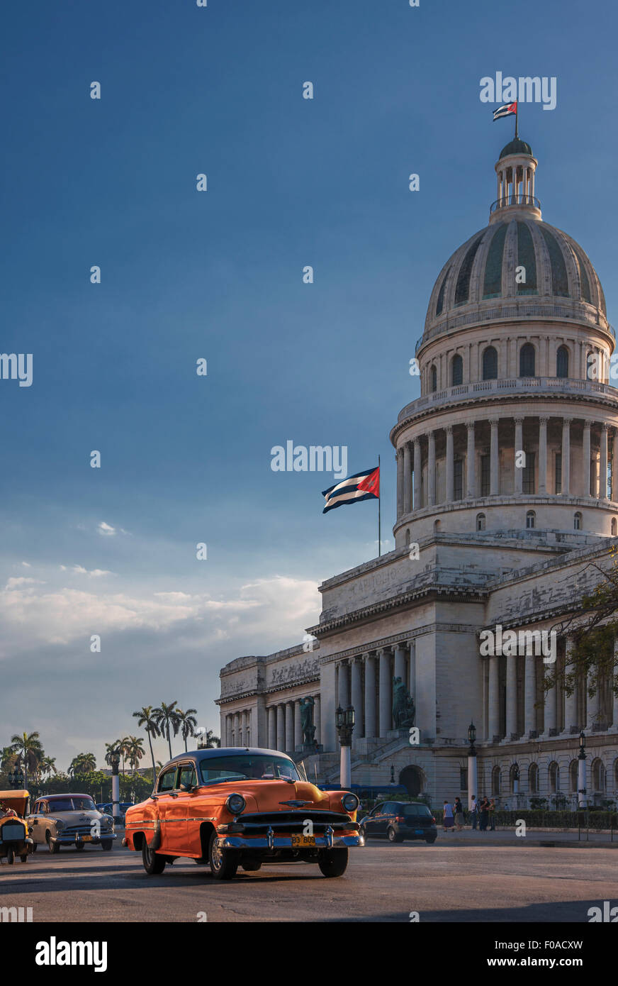 Vintage car driving in front of Capitol Building, Havana, Cuba - Stock Image