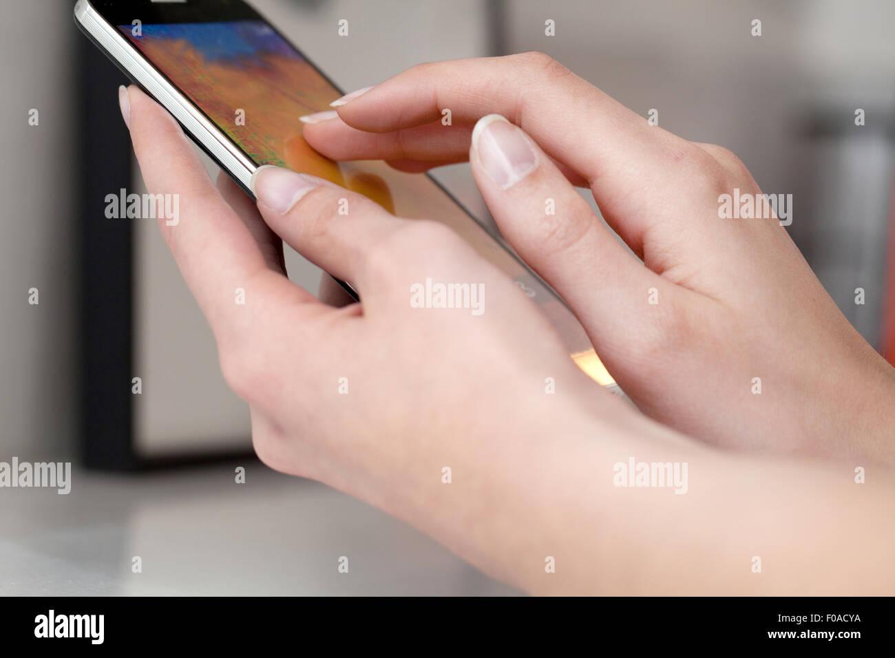 Female hands using smartphone - Stock Image