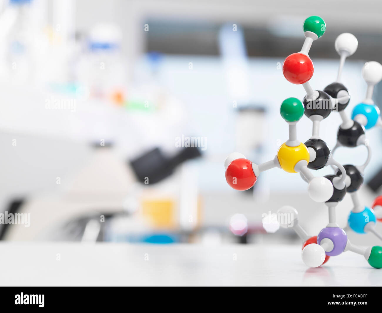Molecular model structure sitting on a lab bench during a experiment. - Stock Image