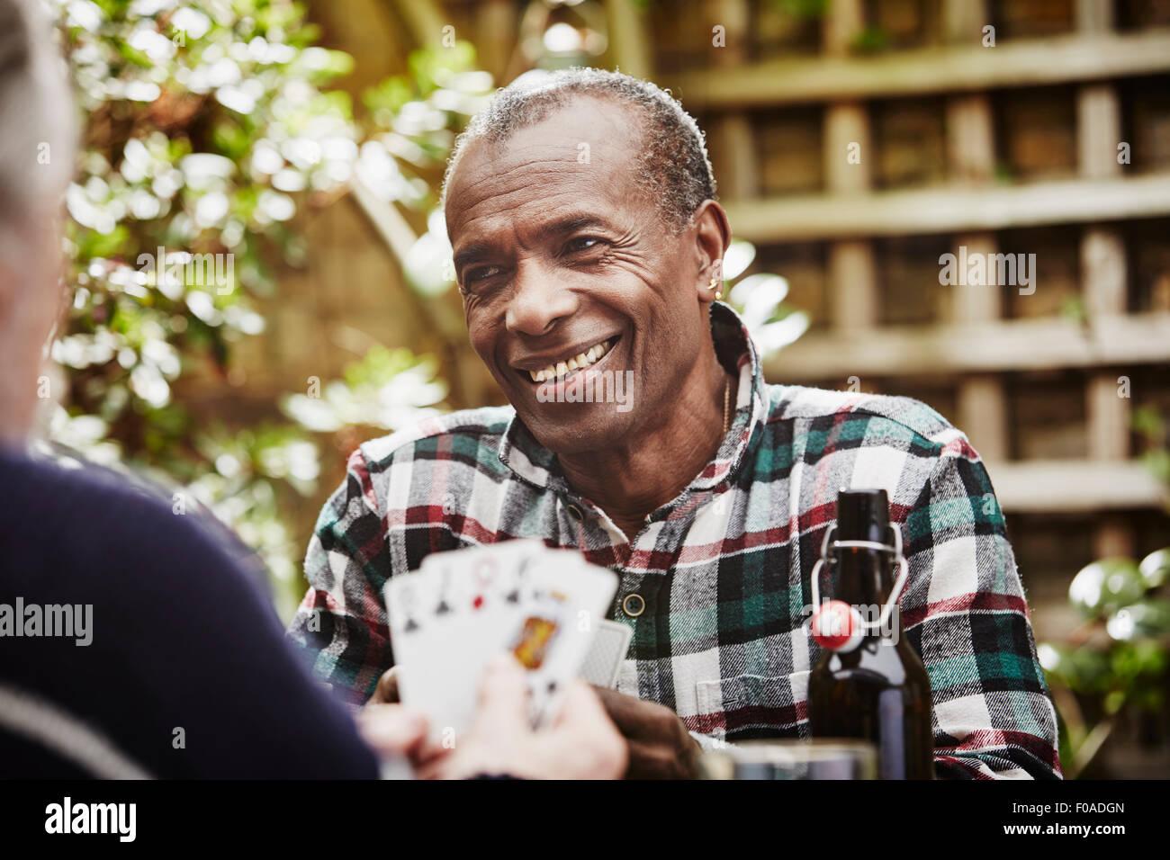 Senior men playing cards - Stock Image